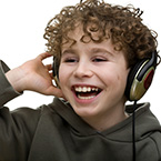 Boy smiling with headphones